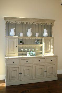 Love the clean lines of the hutch, and the pure white vases. This is an amazing shot