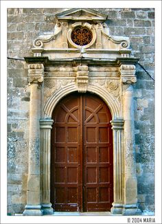 Europe Greece Ionian Islands Lefkada   Lefkada - A very old door by Maritsa. Is this Ai Mina, Ai Spyridon or Pantokratora.  I should have paid more attention when dad was pointing them out. Venetian influence very obvious.
