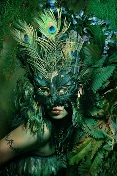 Green peacock feather mask.