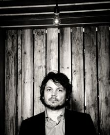 Jeff Tweedy from Wilco is my husband's doppelganger.  Freaks me out every time I see a pic of him!