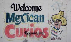 Welcome Mexican Curios Shop Sign