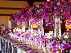 purple, radiant orchid wedding reception. Orchids, roses, and hydrangea centerpiece.