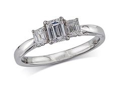 Platinum set three stone diamond engagement ring, with a certificated emerald cut centre in a four claw setting, and one emerald cut on each shoulder. Perfect fit with a wedding ring. Total diamond weight: 0.81ct  A 0.44ct centre, Emerald, H, Three stone diamond ring. You can reserve online and view in store at Michael Jones Jeweller, Northampton