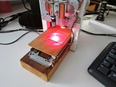 A laser engraving machine , is a tool that uses lasers to engrave an object.     To build this tool I've used two old CD-ROM writer that lay...