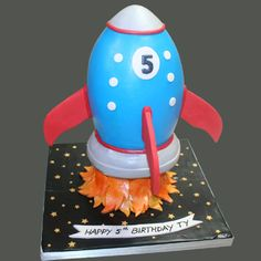 I have no idea how you'd slice this. I'm guessing the flat cakes would be easier to make, but I couldn't resist this one! Happy 5th Birthday, Boy Birthday Parties, Birthday Cake, Birthday Ideas, Rocket Cake, Astronaut Party, Flat Cakes, Space Party, Kids Party Themes