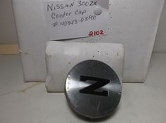 1984-1993 Nissan 300Zx  wheel center cap p/n 40343-03P00 hub cover metal    2102 #nissanoem