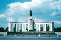 A typically tasteful monument from Soviet Russia, featuring a giant soldier with a machine gun. The photo does not show the tanks at either end. West Berlin, East Germany, Statue Of Liberty, Places Ive Been, Russia, History, Building, Travel, Tanks