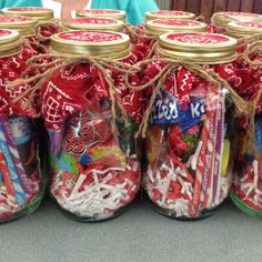 Easy and cheap gift idea. Mason jars filled with candy and toys from the dollar . Easy and cheap gift idea. Mason jars filled with candy and toys from the dollar store. Put some fabric under the ring an. Dollar Store Christmas, Christmas Jars, Diy Christmas Gifts, Valentine Gifts, Christmas Baskets, Christmas Candy, Mason Jar Candy, Mason Jar Gifts, Mason Jar Diy