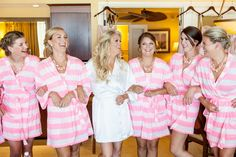 cute bride and bridesmaids getting ready in robes! #pink