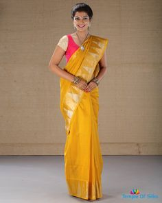 Plain yellow temple border saree