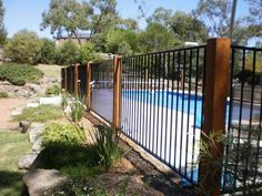 32 Awesome Stylish Pool Fence Design Ideas - Swimming pool fences are expected to secure babies and little youngsters. These systems keep kids from the dangers of suffocating and let them approac. Aluminum Pool Fence, Glass Pool Fencing, Metal Pool, Wooden Pool, Backyard Pool Landscaping, Backyard Fences, Landscaping Ideas, Desert Backyard, Backyard Ideas