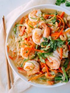This easy dish of vegetable noodles with shrimp is a light, delicious meal of zucchini noodles, carrot noodles, and glass noodles simmered in chicken stock Vegetable Noodles, Zucchini Noodles, Rice Noodles, Carrot Noodles, Pork Noodles, Asian Noodles, Noodle Recipes, Shrimp Recipes, Chow Mei Fun