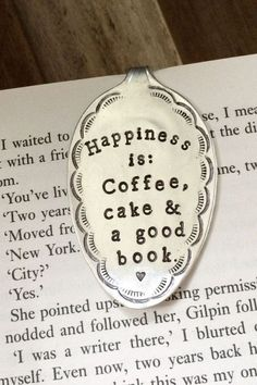 """A Vintage silver plate teaspoon that has been lovingly flattened & hand stamped and repurposed into a funky little bookmark. Stamped with the phrase """"Happiness is: Coffee, cake & a good book."""""""