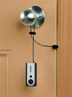 A portable security system that sounds an alarm if someone attempts to enter the room.