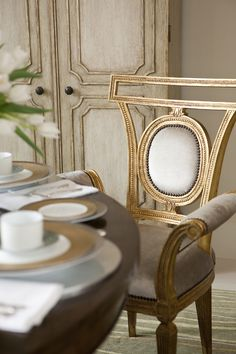 Hand-carved arm chair in cream painted finish with Borghese accents and antiqued nailhead trim.