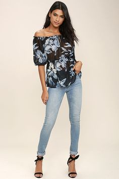 Yes, honey! The Giving Me Life Black Floral Print Off-the-Shoulder Top is earning all the praise with its sheer, woven construction, black and blue floral print, and elasticized off-the-shoulder half sleeves. Ruffled hem.