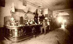Two Barmen Tend to An Old West Saloon.