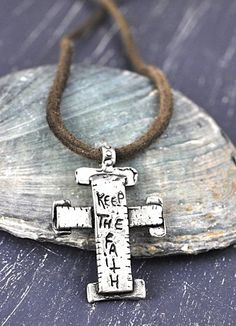 "Strong Faith Necklace.  Cross necklace with Soft brown leather lace is strung through an oversized organic cross that reads a reminder to ""keep the faith"" on the reverse side. $62  #crossnecklace #crossjewelry #inspirationalnecklace #inspirationaljewelry  islandcowgirl.com"