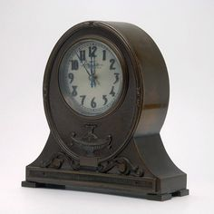 Bronze Shield Back Clock, Chelsea Clock Co. Boston {Height 6 inches; length 5 3/4 inches}