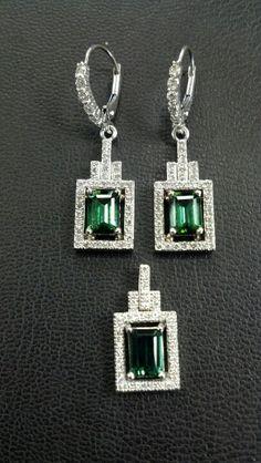 14k white gold indicolite tourmaline and diamond earrings to match customers pendant. Diamonds are 1mm bead set.