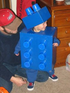Lego Halloween costume made out of cardboard boxes & solo cups, then painted blue....Too cute!