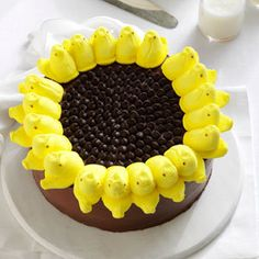 Serves 12  Ingredients 1 package yellow cake mix (regular size) 2 cans of chocolate frosting (16 ounces each) 19 yellow Peeps chicks 1 1/2 cups semisweet chocolate chips  Prepare and bake cake mix according to package directions, using two parchment paper lined and greased 9- inch round baking pans. Cool in pans 10 minutes before removing to wire racks, remove paper. Let cool completely.  If cake layers have rounded top, trim with long serrated knife to m…