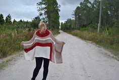 This beautiful and easy to knit poncho is an incredibly flattering accessory for anyone's wardrobe. It is as soft and cozy as wrapping yourself in a blanket, but flattering enough to wear just about anywhere. Paired with boots and skinny jeans, it is a chic look with minimal effort. The horizontal hem is very flattering and buttoning up the sizes for mock sleeves makes this a very practical accessory, too.