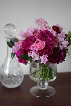 Soft pinks and delicate peaches are contrasted with rich plums and crimson. Flowers are grouped in loose gatherings with strong emphasis on textural foliages giving Lavish its garden-inspired style. Seeded eucalyptus, pepperberry, Peonies, dahlias, hydrangea, garden roses and amaranthus: all are Lavish choices.