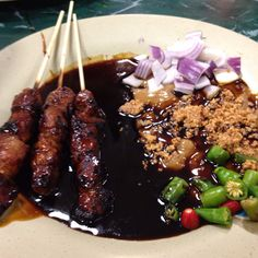 Sate kambing - goat satay with sweet soy sauce, diced shallots, tomato, and fiery cut cabe rawit (chili padi or thai chili)