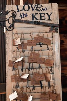 "Wooden skeleton keys + mini clothes pins + spray painted shutter = seating ""cards"" (table # on back)"
