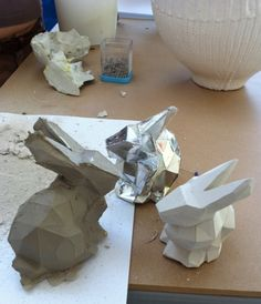 my facetted paper bunny, now available as DIY kit, made into ceramics. From paper to mold, to clay, to bake and glazed ceramics... long process!    from my website at liselefebvre.com