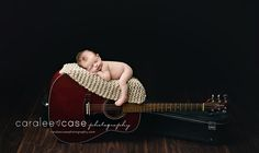 Caralee Case Photography.  Newborn Infant Baby Photographer.  Guitar.  ***Please note:  this shot is a composite.  Parents hands were on baby to ensure safety at ALL times***
