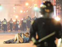 Riot Kissing Couple in Vancouver