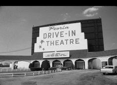 This is the Peoria (Illinois) Drive-In where Carol grew up. A schoolmate lived just behind this theater's screen. They used to slip in and turn up the back row of speakers & watch the movie from her backyard.
