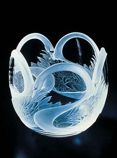 Photograph:A glass bowl with a swan design was made in the 20th century by…