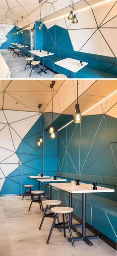In this modern cafe, pale lime-washed birch panels have been paired with a rich teal color to accentuate the geometric patterns. #moderninteriordesigncafe