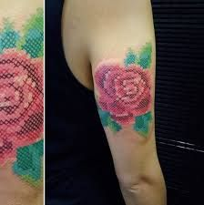 What does cross stitch tattoo mean? We have cross stitch tattoo ideas, designs, symbolism and we explain the meaning behind the tattoo. Cross Stitch Tattoo, Cross Stitch Rose, Cross Stitch Flowers, Home Tattoo, Tattoo You, Leg Tattoos, Flower Tattoos, Tatoos, Rain City Tattoo