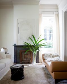 A custom mohair rug adds another layer of softness to the leather, fur, and linen in a living room by Ann Holden.