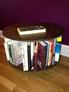 This sleek circular bookcase makes looking for a book as easy as a simple twirl. It sits on three wheels and can turn a full 360 degrees. Narrow Bookshelf, Revolving Bookcase, Bookcase Desk, Bookshelves, Pinterest Home Decor Ideas, Colour Pallete, Stain Colors, Solid Pine, Book Worms
