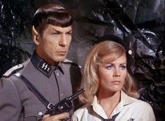 "Federation Commander Spock of the USS Enterprise, dressed as an Ekosian Nazi, holding a Colt Police Positive on Daras (Ekosian Nazi hero who's actually a member of the resistance against the Fuhrer, John Gill, who's actually a Federation ""cultural observer"" and HUGE Prime Directive violator - Star Trek rocks!)"