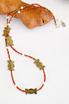 Beautiful design inspiration in this Red beaded necklace. Make it yourself with red African seed beads and brass baule beads from Ghana. Buy beads at Rexbeads.com.   African necklace African red necklace  Purchase completed necklaced at : https://www.etsy.com/listing/518950739/red-beaded-necklace-african-necklace?ref=shop_home_active_22