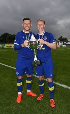 Everton captain Gethin Jones (L) and goal scorer Harry Charsley (R) celebrate with the trophy after the Super Cup NI under 21 final at Ballymena Showgrounds on July 23, 2016 in Ballymena, Northern Ireland.