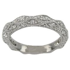 Very intricate band with tiny diamonds - needs a lovely engagement three stone to go with it!
