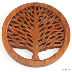 This unique and beautiful trivet is made of sheesham wood, also known as Indian Rosewood, native to the Indian subcontinent. It is in the city of Saharanpur, a traditional center of wood carving, wher Scroll Saw Patterns Free, Scroll Pattern, Cross Patterns, Tree Carving, Chip Carving, Wooden Shapes, Wood Tree, Woodworking Patterns, Wood Sculpture