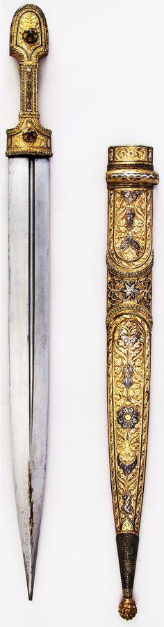 Caucasian kindjal / qama dagger, early 19th century, steel, silver, niello, gold, L. with sheath 21 in. (53.3 cm); L. without sheath 19 15/16 in. (50.6 cm); L. of blade 15 in. (38.1 cm); W. 1 5/16 in. (3.3 cm); D. 1 1/16 in. (2.7 cm); Wt.13.5 oz. (382.7 g); Wt. of sheath 8.5 oz. (240.9 g), Met Museum.