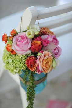 Flower arrangements in mason jars for the aisle chair decoration
