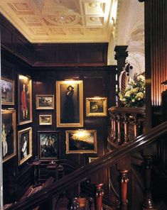 Grouping of portraits hung in a grand staircase at Ralph Lauren store
