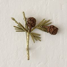"Hand-cast in a mold created directly from a sequoia sprig, this oxidized bronze pin was crafted by New York designer Michael Michaud.- Bronze- Handmade in the USA3""W, 2.75""L, 0.5""D"