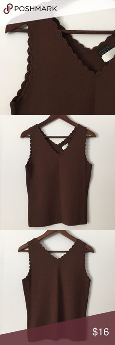 Beautiful scalloped neck, brown knit tank top sz S Beautiful scalloped neck, brown knit tank top. Size: S. Length: 22 inches. Chest: 16.5 inches. V neck. Amazing quality knit. Beautiful scalloped crouched detail at neckline. Just dry cleaned! Great preowned condition. Tops Tank Tops