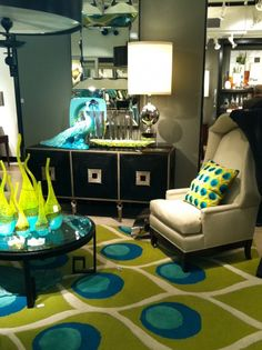 The peacock's plumage made a grand appearance at High Point this year. Its signature hues of turquoise and green are widespread in the latest home décor trends from area rugs to statues.